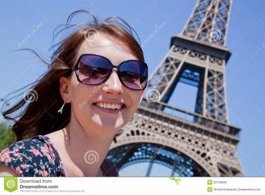 Very pretty woman by Eiffel Tower