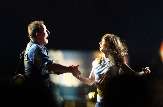 "UK fan Rachel Gould dances with The Boss onstage in ""Springsteen & I"""