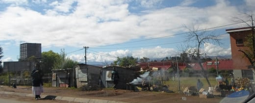 Shops of corrigated-iron @ Lesotho © Martie Coetser