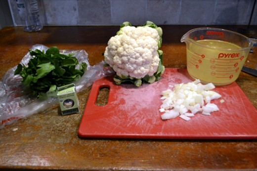 The ingredients... from left to right: watercress, white pepper, cauliflower, onion, and stock (either chicken of veggie if making vegan)