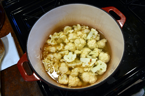 With the stock and cauliflower added, cover and simmer until tender.