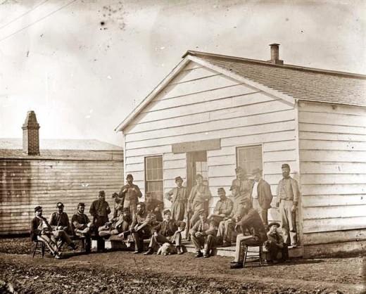 Troops lounge outside a Barracks