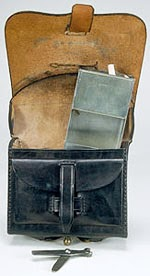 Fig. 13: Interior of the Cartridge Box, with one of the two Tins to hold cartridges, and the tool to dismantle the musket