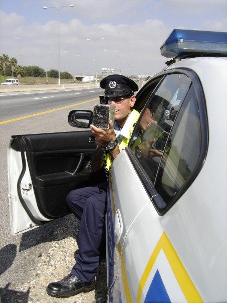 An Israeli police officer using a laser radar gun.