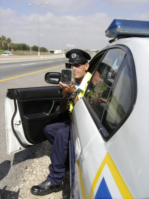 An Israeli police officer using a laser radar gun.