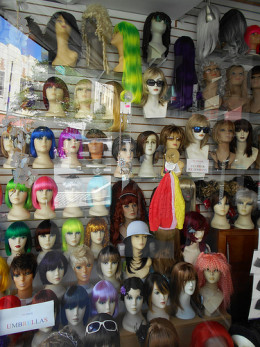 Try on wigs to test if a brown hair color suits you.