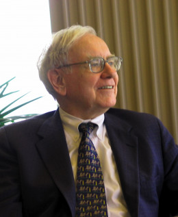 Warren Buffet is smiling. Yet, he claims he doesn't make any business decision with emotions like happiness!