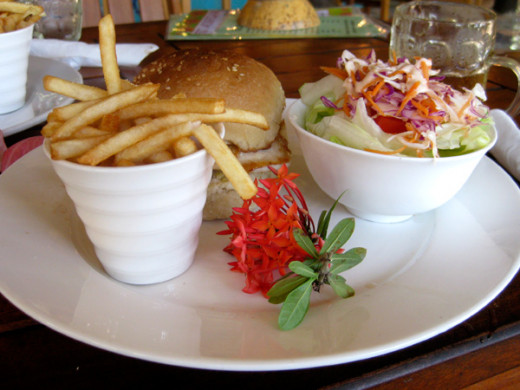 A Fijian hamburger, chips and salad.
