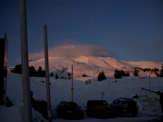 A winter shot of Mt. Hood from Timberline Resort parking lot. According to Tim Windell, it got its name from the cloud caps it gets.