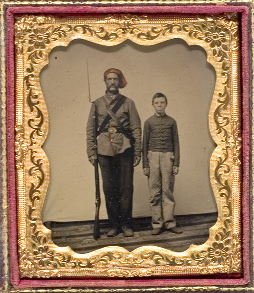 Militiaman and drummer boy for a Massachusetts unit. Note the gray uniform - blue was not the standard color for all Union forces when war broke out.