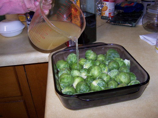 Here I show the broth being added to the prepaired brussel sprouts.