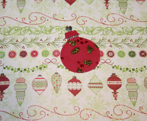I colored the embossed images of holly berries with glitter glue.