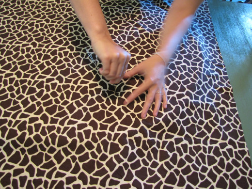 Here we are tufting the buttons through the top of the fabric and into the foam.