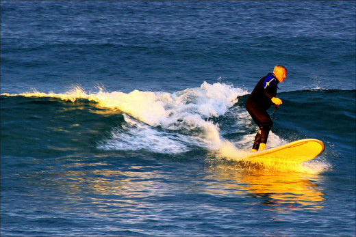 Surfing during sunset
