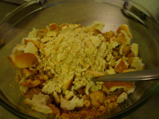 Crumble cornbread into bowl and add crumbled bread.