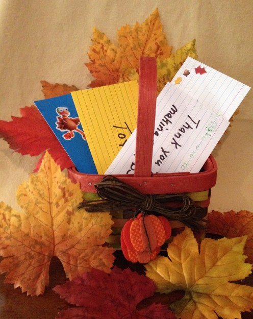 A simple basket filled with prompt cards can be the centerpiece of the Thanksgiving table.