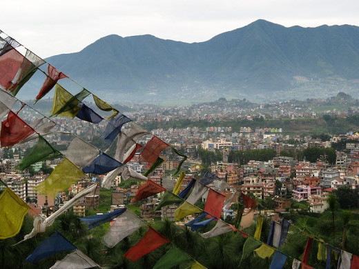 Prayer flags flutter over Swayambhu temple. A beautiful view of Kathmandu is to be had from this high vantage point.