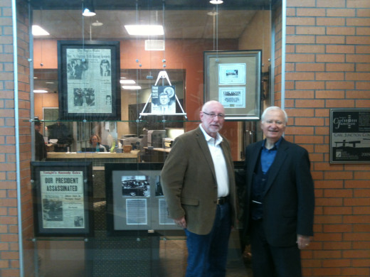 Local historian Allen Shirley (on right) with a history buff at Shirley's exhibit in our Community Center.