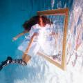 Through This Mirror: A Free Form Prose Poem