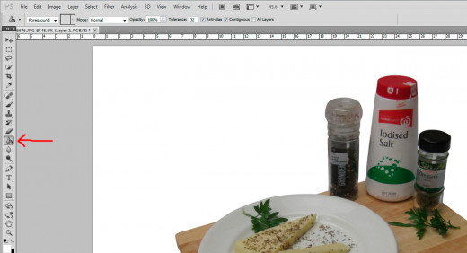 12. Click the paint bucket icon and then click it onto the image. The background will turn white.