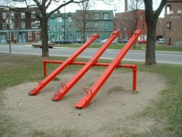 """The closer the """"load"""" (or person on the seesaw) is to the fulcrum (or center of the seesaw) the more balanced the seesaw will be."""