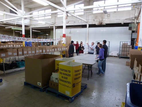 Volunteers prepare to package food hungry people in their community
