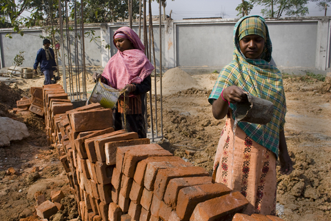 Women work at a construction site in India. Fair Trade can often provide an easier more fulfilling way of making a living.