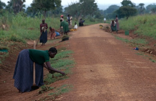 Women in Uganda help with road building. Bead For LIfe lifts such workers up out of poverty and backbreaking labor.