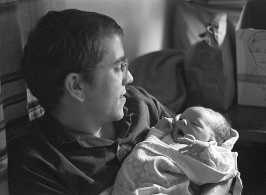 New dad holding baby : Creative commons licensed via Flickr