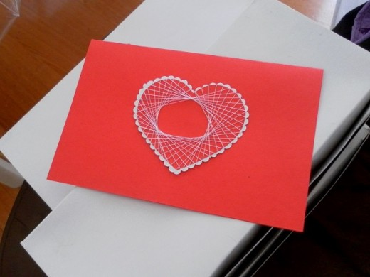 Heart shaped spirelli string art pattern on a handmade card