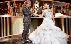 """Stanley Tucci is Ceasar Flickerman, the emcee we love to hate and Jennifer Lawrence is Katniss Everdeen, the lovely """"girl on fire"""" in The Hunger Games: Catching Fire in theaters now."""