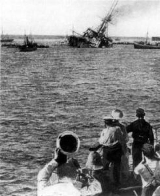 British battleship HMS Majestic sinks from hitting a mine.