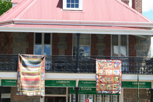 Brick, iron and quilts. The quilt display extended the length of the main shopping area.