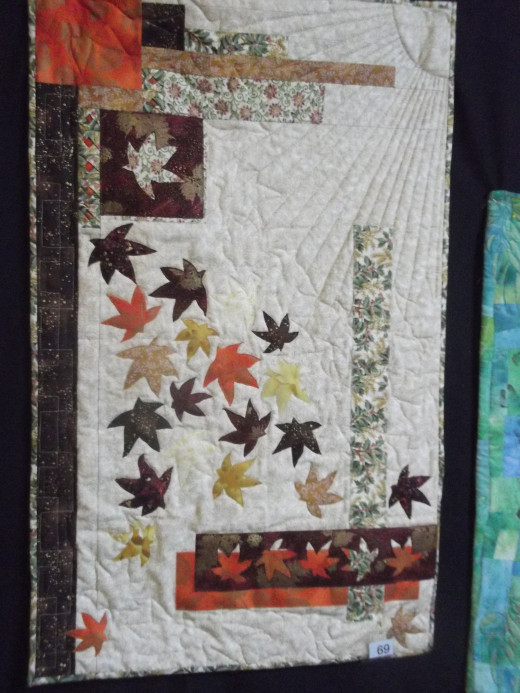 I admire this quilter's creative flair. It inspires many other possible designs featuring shapes other than leaves.