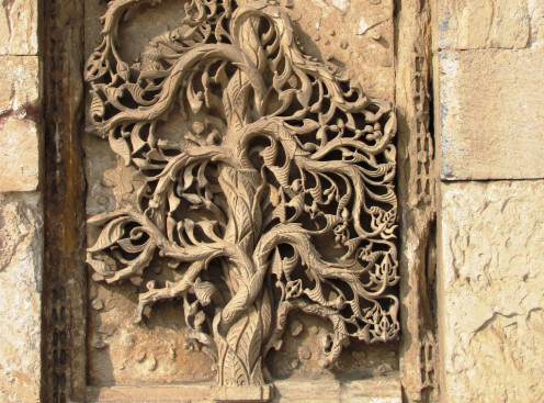 An intricate carving, partially damaged, at the mosque