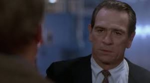 Tommy Lee Jones works for the U.S. Marshalls and he is sent to hunt down The Fugitive.