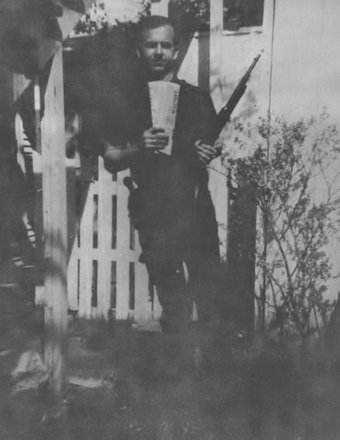 Lee Harvey Oswald posing  with rifle he later used to assassinate President Kennedy