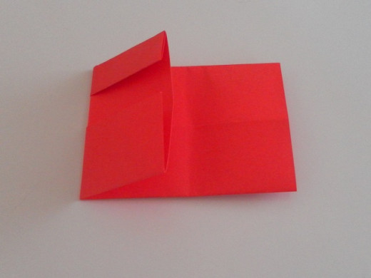 Divide into thirds and fold the left one-third portion of the paper over the centre portion.