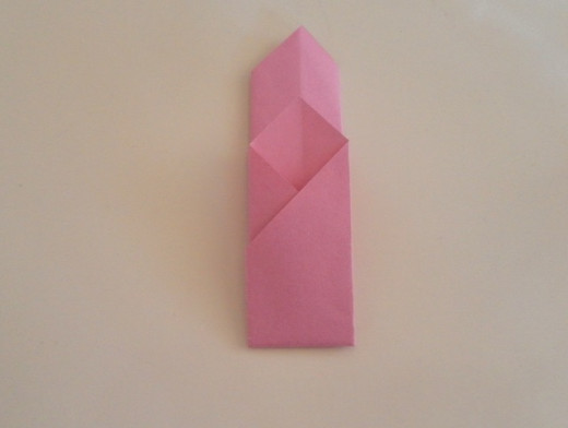 Bring the bottom end of the paper up and make the fold. The bottom flap should be shorter than the top part.