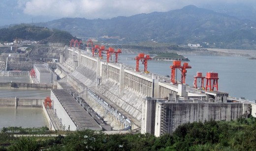 Spanning the Yangtze River, the world's largest hydroelectric river dam, when fully operational, will provide power and improve flood control. Its social costs included relocating a million people.