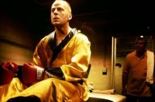 Bruce Willis plays a professional boxer in Pulp Fiction. He is paid to throw a fight but he has other plans.