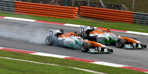 Paul di Resta overtaking Adrian Sutil at Malaysia in 2013.