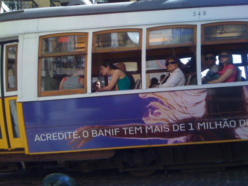 Riding the street car in Lisbon.