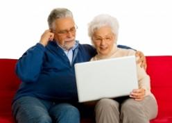 Seniors who keep their minds sharp work on their computer.
