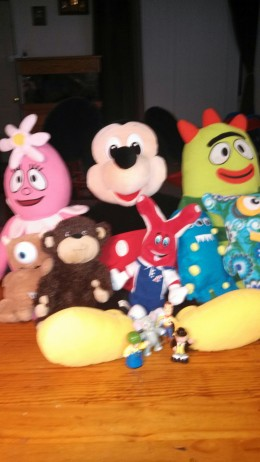 Sweet little stuffed toys who are 'listening' nicely as the little Elf reads to them...