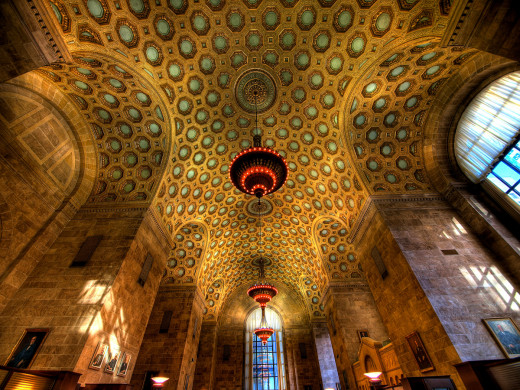 High ceilings are the perfect place for chandeliers, like the high ceiling in the Commerce Court in Toronto.