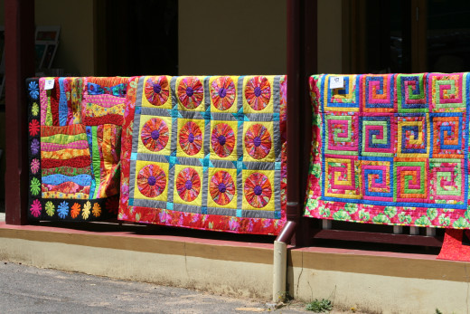 Traditional quilt designs are always eye-catching. They can easily be created using recycled fabrics, allowing you to sleep wrapped in your memories. :)