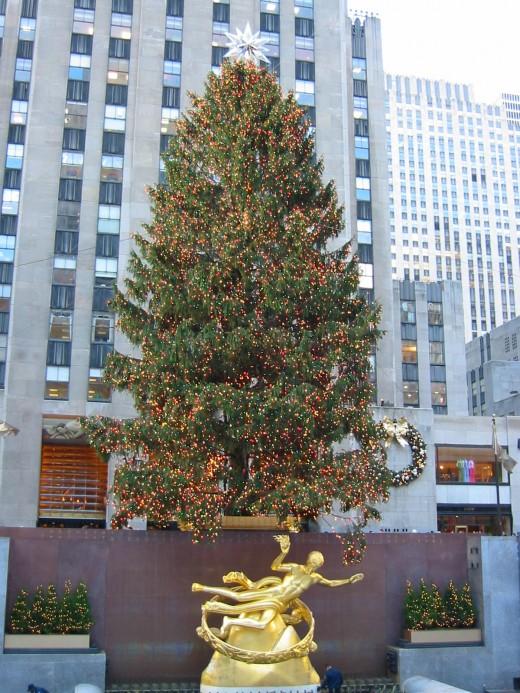 Rockefeller Center Christmas Tree With Sculpture Below It