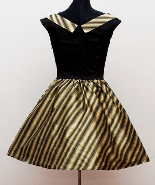 Chose a custom made velvet dress for the flower girl or candle lighters.