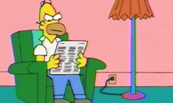 Angry Dad angrily reading the newspaper.